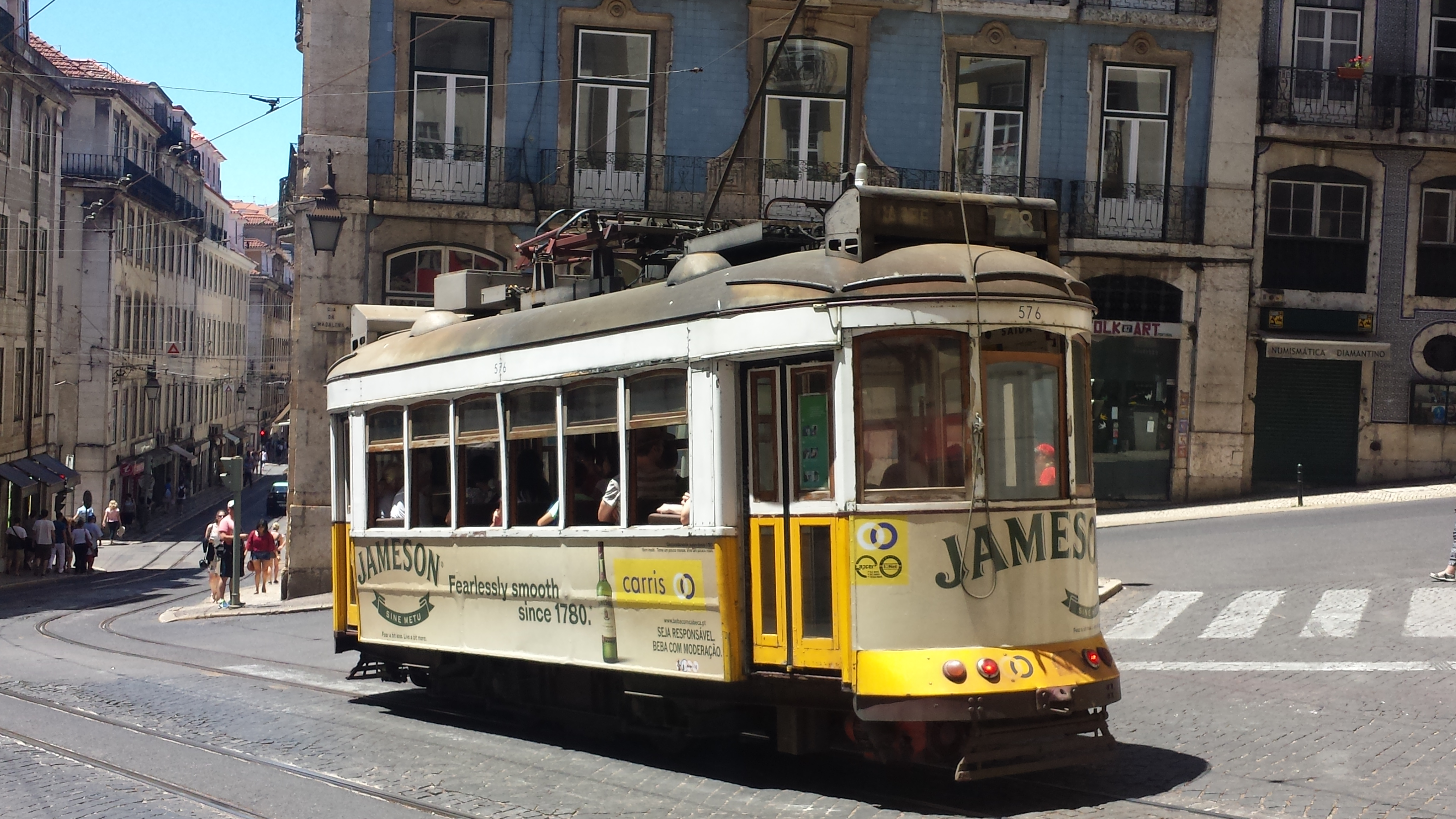 Vintage cable-car cruises down Lisbon streets